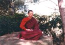 Geshe-la meditating on a rock