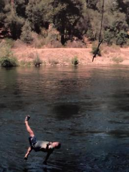 Frank jumping off a rope swing with a caption