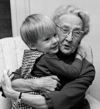 1960s-grandmother-in-chair-hugging-vintage-images (2)