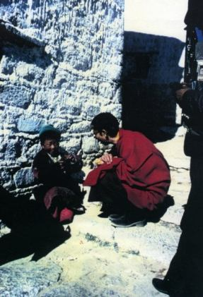 Geshe-a in Tibet with child